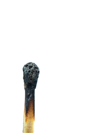 vacate: a burnt match up close  against a white background