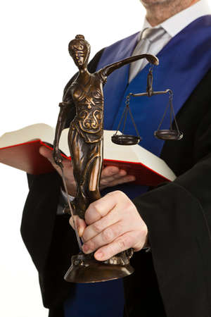 verdicts: a judge with a law book in court  with justice figure in the hand  Stock Photo
