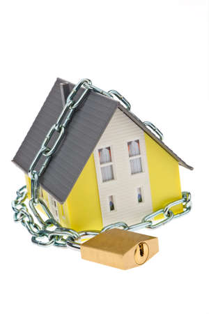 a house with chain and lock shut  alarm and security  Stock Photo - 13143330