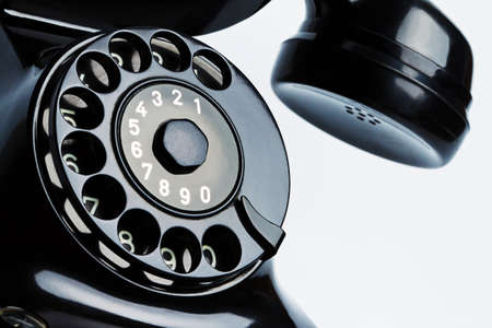 retro phone: an ancient, antique telephone  isolated on white background, and released