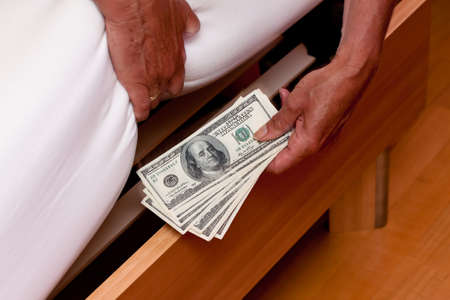 many dollar bills are hidden under the bed Stock Photo - 13143421
