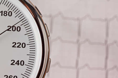 blood pressure measurement and ecg curve  sickness due to high blood pressure  photo