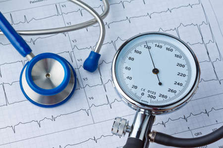 increased: blood pressure measurement and ecg curve  sickness due to high blood pressure  Stock Photo
