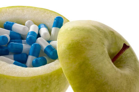 apple with tablets capsules representative photo of vitamin tablets Stock Photo
