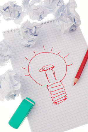 light bulb on drawing as a symbol of new ideas  photo