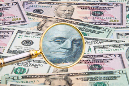 many dollar bills photographed with a magnifying glass  close up Stock Photo - 13143704