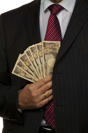 owe: manager with japanese yen bank notes in his hand Stock Photo