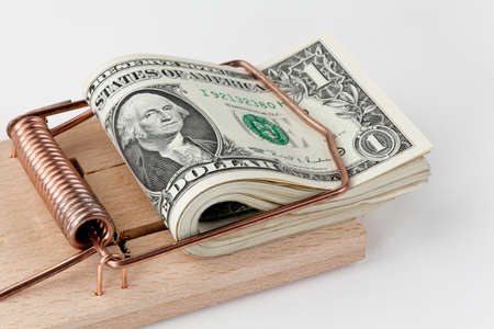 traps: many american dollar bills in mouse trap  debt trap