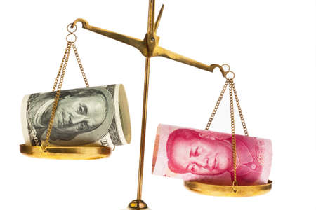 rmb: american dollars and chinese yuan currency on a scale Stock Photo