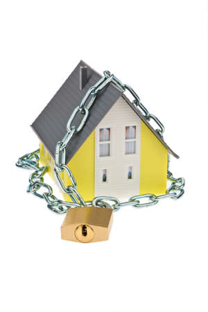 padlock shut off: a house with chain and lock shut  alarm and security  Stock Photo