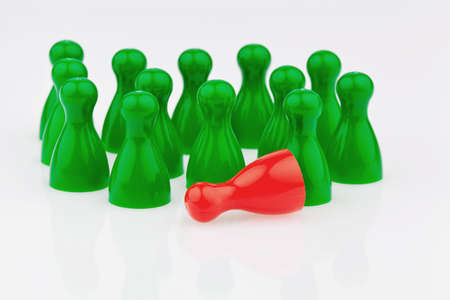 red and green characters  bullying, loneliness and outsider in the team  Stock Photo - 13507471