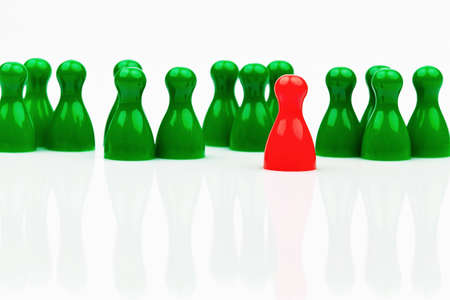 quota: red and green characters  in contrast team  quota for women in the workplace  Stock Photo