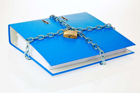 self contained: a filing with chain and padlock closed  privacy and data security  Stock Photo