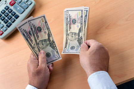seem: many dollar bills are counted Stock Photo