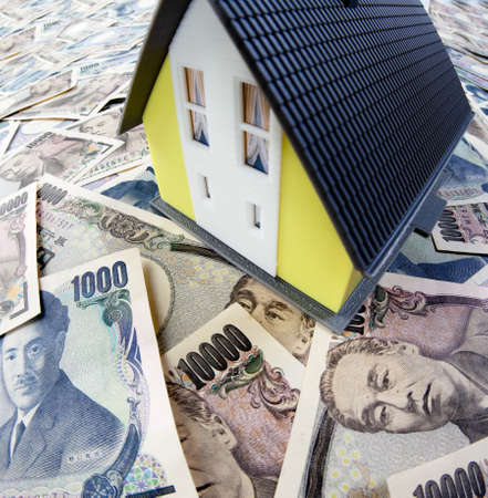 modell: japanese yen and the house  Stock Photo