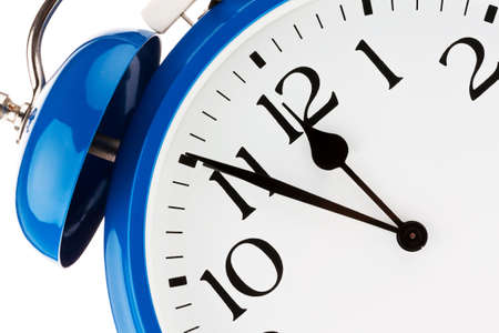 time pressure: 11 55 on a clock  time for decisions Stock Photo