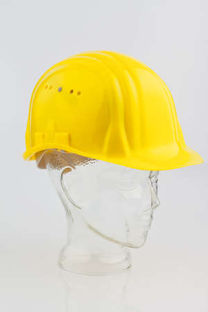 bauhelm a construction worker isolated on a white background photo