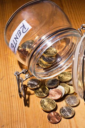 eventide: coins in a jar  the provision for old age is always less  poverty in retirement   pension  Stock Photo