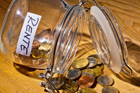 provision: coins in a jar  the provision for old age is always less  poverty in retirement   pension  Stock Photo