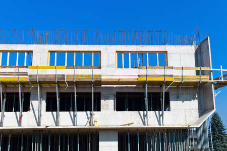 financed: a house or a hall is built of concrete  site  site  formwork for concrete