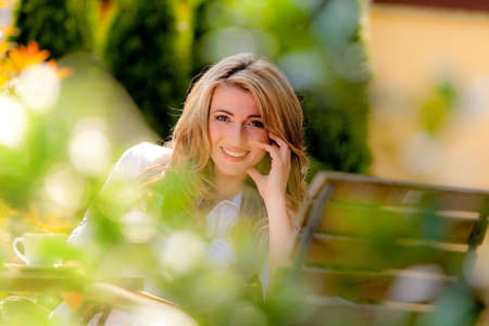 portrait of a cheerful young woman in the garden photo