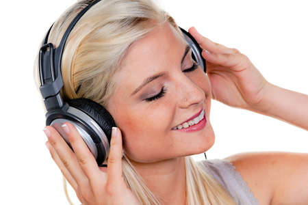 hark: woman with headphones listening to music for relaxation