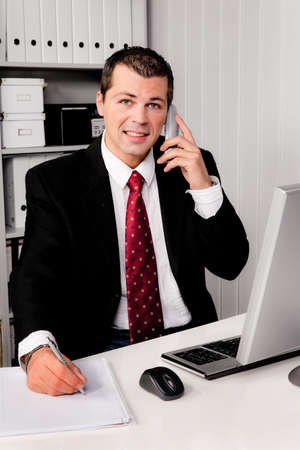 freelancers: young businessman in office with telephone