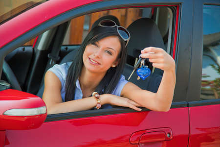 motorist: young woman with new car and car keys Stock Photo
