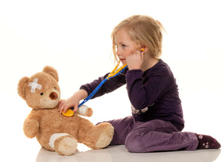 doctor toys: child with a stethoscope as a medical doctor  pediatrician examined patients
