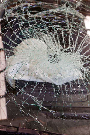 a broken windshield and an airbag during a car accident photo