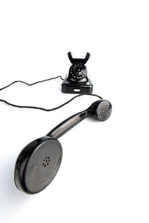 an old, old landline telephone  phone on a white background Stock Photo - 13776561