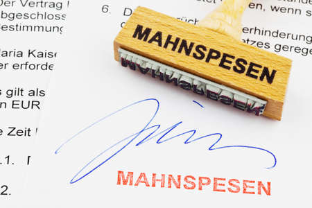 dimissal: a stamp made of wood lying on a document  german inscription  reminder