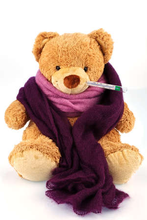 bedridden: a plush bear with a thermometer in your mouth  representative photo of chills, fever and flu