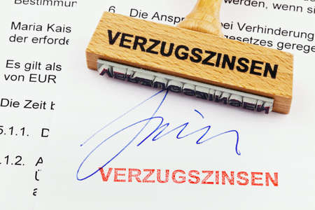 vacate: a stamp made of wood lying on a document  german words  interest