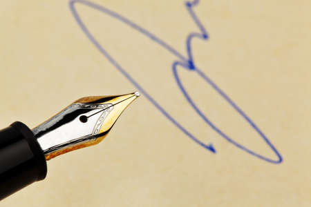 notieren: the spring of a fountain pen and a signature  symbolic of contracts, and will sign