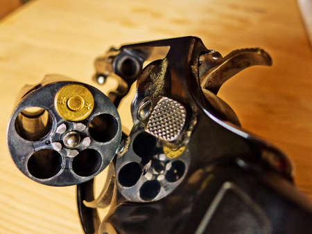 suicidal: a revolver with one cartridge  representative photo of russian roulette  Stock Photo