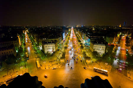 paris, france  the view from the arc de triomphe to the city at night on the champs-elysees photo