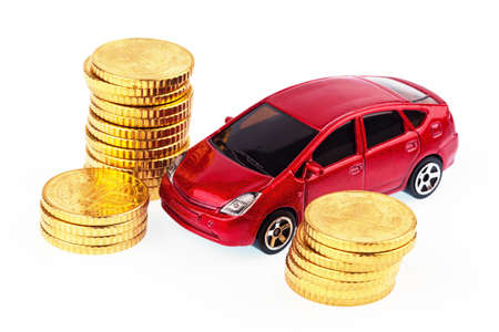 auto leasing: a model car and coins against white background, photo for price increases, fuel costs and car expenses