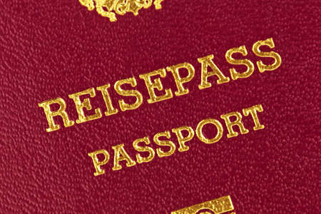 a red passport of the european union is on a white background  photo