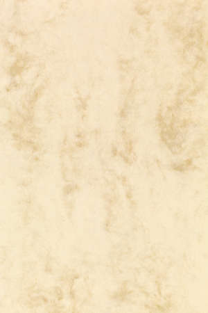 a yellow, blank sheet of stationery with a marbled structure