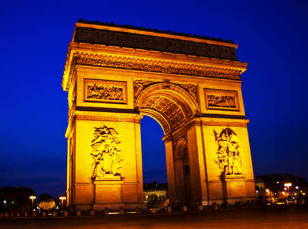 the arch of triumph  arc de triomphe  in paris, france  one of the landmarks of the city  at night  photo