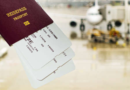 appropriate: a passport and boarding pass to the airplane at an airport