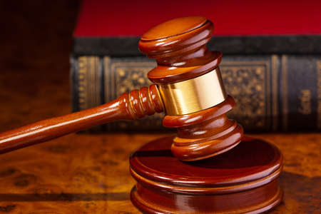 bankruptcy: the gavel of a judge in court  lies on a desk