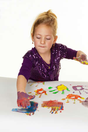 a child paints with finger paints  funny and creative  photo