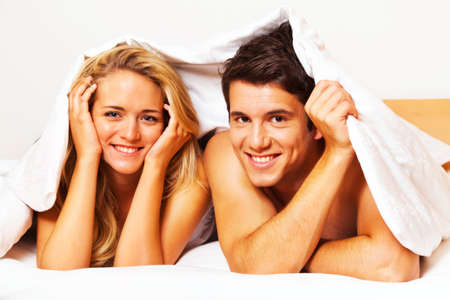 eroticism: couple has fun in bed  laughter, joy and eroticism in the bedroom