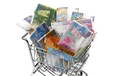 foreign currency: swiss franc money bills in a basket