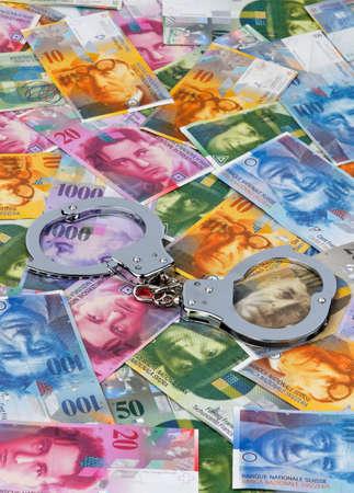 swiss franc: swiss francs  money in switzerland  with handcuffs