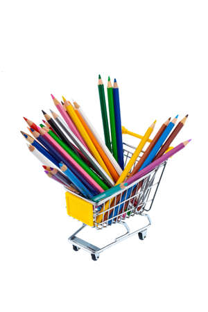 stationery needs: crayons many different colors in a shopping cart