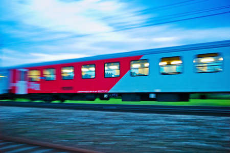 admitted: a passenger train travels through the night  night train with people of the öbb Stock Photo