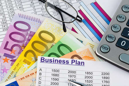 founding: a business plan for starting a business  ideas and strategies for self-employment  euro bank notes and calculator